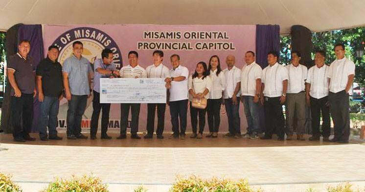 CAPITOL TURNS OVER PHP 6.5M CHECK TO SALAY LGU OFFICIALS